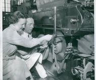 Swedish Tobacco Monopoly STM. Signe Sävström and engineer Sixten Strømquist help to put the tobacco band on the machine