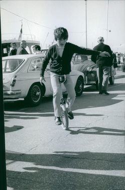 A young boy riding a unicycle. April 10, 1970