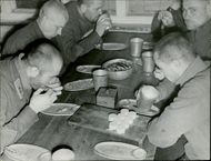 Russian prisoners of war eating food in the pantry. 1940