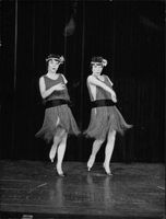 Female performers dancing on stage.