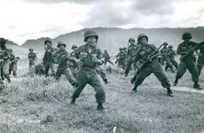 Soldiers from Vietnam training on the ground.