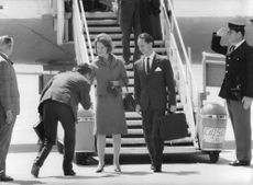 Princess Irene with Carlos Hugo, just get off the plane with a man welcoming them, 1964.