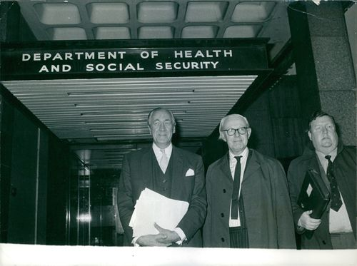 Doctors standing in front of a building.