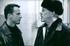 Aidan Quinn and Donald Sutherland in the 1997 film The Assignment.
