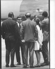 Pierre Salinger (former press secretary for John F. Kennedy) with people at Los Angeles airport before departure of airplane.