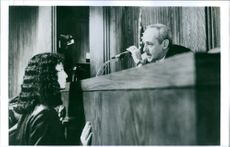"""A photo of Cher and John Mahoney from the film """"Suspect"""". 1987."""