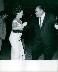 Robert Middleton dancing with a woman.