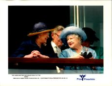 Mother and Daughter, Queen Elizabeth II and Queen Elizabeth. In the background see Sir Angus Ogilvy.