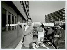 Ice hockey player Sven Tumba arrives with his hockey clubs for the Winter Olympics in Innsbruck in 1964