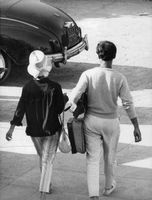 Rear view of Pascale Petit and Giani Esposito walking.