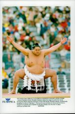 """Japanese sumo champion Akebono performs a """"dezuiri"""" ritual at the opening ceremony of XVIII Winter Olympics Games."""