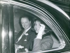 John Spencer-Churchill and Athina Livanos his former spouse sitting inside the car, 1961.