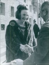 Princess Irene shaking hands with unknown man. 1964