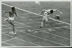 Otis Davis and Karl Kaufman jump into goals during the Olympics