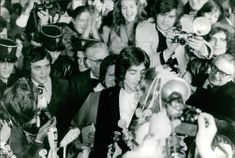 Sheila and Ringo surrounded by photographers and fans on their wedding day.