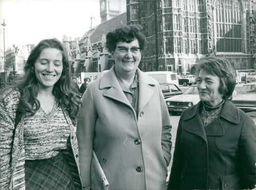 Helene Hayman, Joan Maynard and Millie Miller smiling, and looking towards the camera.