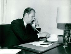 Vittorio Emanuele, Prince of Naples talking over the phone on his desk, October 1967.