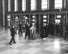 Pope Paul VI being welcomed inside a building during his Papal Visit.