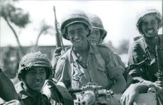 Soldiers sitting, smiling, in Israel.