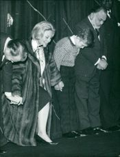 Michèle Morgan with others on stage.