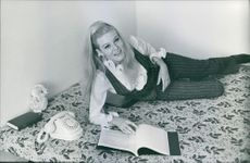 Olinka Bérová pictured laying on bed. 1967.