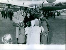 A photo of an Italian-born actress who first became famous as the twin sister of film star Pier Angeli  Marisa Pavan at airport with family members.