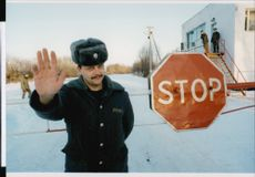 Guards prevent the public from entering the forbidden zone around Chernobyl.