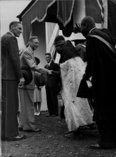 "King George VI is greeted by Queen Shepherd ""She Elephant"" in Swaziland"
