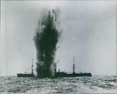 A bombed ship in the sea during WWI, 1917.