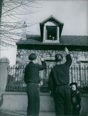 A man waving on the top of the house 1949.