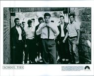 A group of men in a scene from the film School Ties.