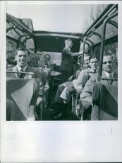 Men siting and traveling by bus. Photo taken in 1939.