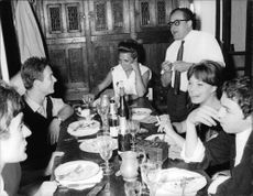 Jacques Charrier having meal with friends.