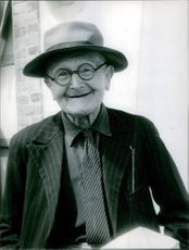 Portrait of an aged man, smiling.