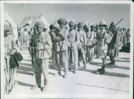 Prisoners being marched away to an unknown destination. 1940.