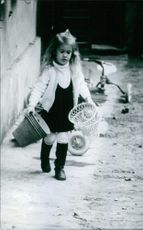 Princess Alexia of Greece and Denmark is carrying pots. 1970