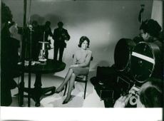 Caroline Maudling sitting on a chair as she pose for the cameras.