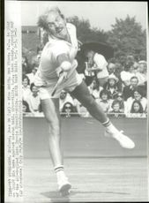 Tennis player Stan Smith plays match against Grover Reid at the All England Lawn Tennis Championship.