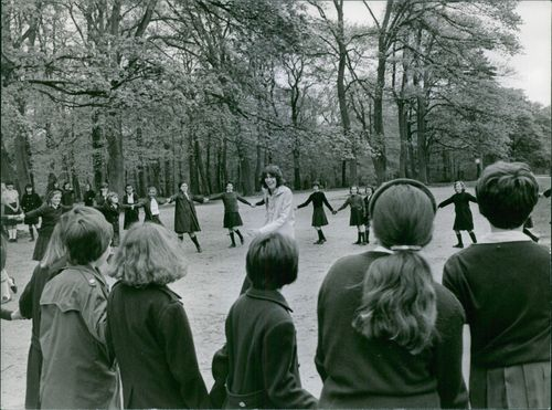 STUDENTS ARE PLAYING IN THE FIELD
