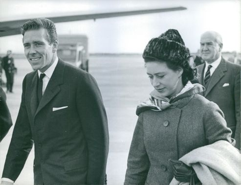 Princess Margaret, Countess of Snowdon looks down as she walks.