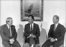 George Herbert Walker Bush sittintg in the center with Imre Pozsgay (Minister of State)