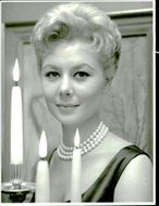 Portrait image of Mitzi Gaynor taken in an unknown context.