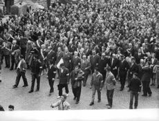 People gathered in the street during Algerian War.