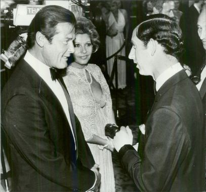 """Roger Moore and his wife Luisa in talks with Prince Charles at the premiere of the James Bond movie """"Deadly Point of View"""" at the Odeon Theater"""
