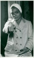 Eartha Kitt in turban and dress
