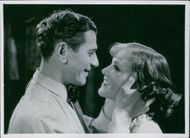 Edvin Adolphson holding the face of Aino Taube as one of the scenes of  the 1938 movie,