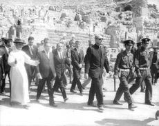 Pope Paul VI walking along with people.