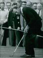 Arnold Palmer playing golf. 1964.