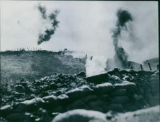 """Smoke from the blast and firing during the war, soldiers hiding in the trench.  """"English war film""""  1936"""