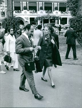 A MAN WALKING WITH A LADY IN STREET